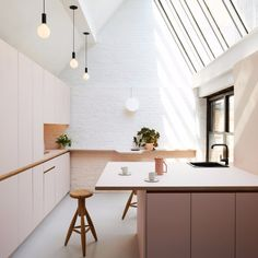 Minimal kitchen made beautiful by skylights and natural light