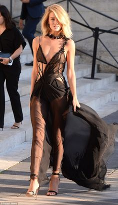 If anybody can wear it...: She certainly proved her worth as one of the world's sexiest models as she allowed the flowing skirt to billow in the wind and reveal even more of her perfect pins