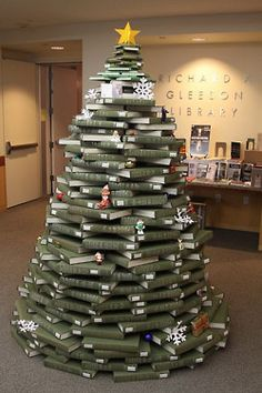 Green books topped off to resemble a Christmas tree in a book store or library. You could make Christmas trees out of almost anything...go on take up the challenge