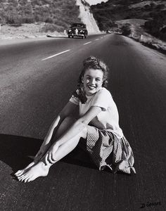 19-year-old Marilyn Monroe sitting in the middle of the Pacific Coast Highway, California. USA, 1945  © Andre de Dienes