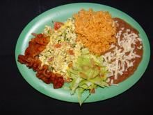 Huevos A La Mexicana :Scrambled eggs with onions, tomato, jalapenos & thre bacon strips  from Pico Pica Rico Restaurant in Los Angeles #Food #Maxican #Restaurant forked.com