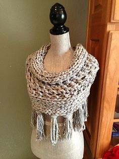 Gray 3 strand cowl with fringe pattern by Louis Chicquette on Ravelry.