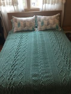 Knitting Pattern for Aran Heirloom Blanket - Cable afghan knit 5 sections and seamed. Finished Size: About 64″ (162.5 cm) wide and 68″ (173 cm) long. Designed by Deborah Newton. Pictured project by BSR123