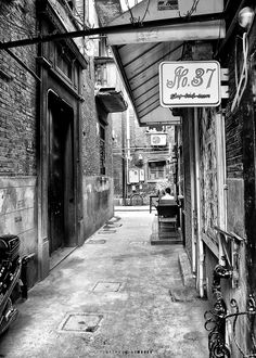 """Shikumen by Joseph Qiu on 500px. Shikumen"""" is a traditional Shanghainese architectural style combining Western and Chinese elements that first appeared in the 1860s. Shikumens are two- or three-story structures resembling Anglo-American terrace houses or townhouses, distinguished by high brick walls enclosing a narrow front yard. The name """"stone gate"""" references these strong gateways.At the height of their popularity, there were 9000 shikumen-style buildings in Shanghai."""