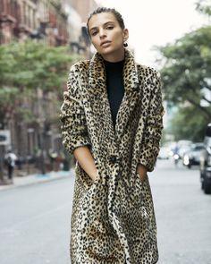 Emily Ratajkowski wears Express Faux Leopard Fur Coat