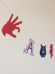 Bear down Wildcats! This U of A inspired garland is great for the Wildcat in your life. Great for tailgating, parties, graduations, and any other occasion to cheer on University of Arizona.  This listing is for 1 set of U of A themed garland featuring six styles. The dye cuts in this garland are cut from good quality, acid-free card stock, and stitched together with 100% cotton black thread. You will receive 1 garland with 18 dye cuts stitched together with white thread :  The garland…