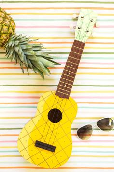 DIY Painted Pineapple Ukulele.  Too adorable for words  -Lovely Indeed