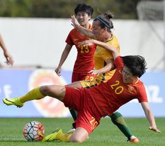 Zhang Rui of China competes for the ball with Lisa De Vanna of Australia during the Women's Algarve Cup Tournament match between China and Australia at Municipal de Albufeira on March 2017 in Albufeira, Portugal. Albufeira Portugal, March 6, Algarve, Sumo, Lisa, Wrestling, Australia, Physical Activities, Dancing