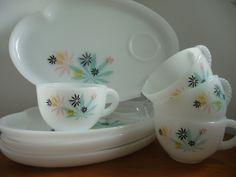 Set of Vintage Milk Glass Snack Plates., via Etsy.