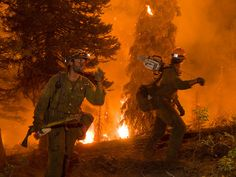Two members of the Idaho City Hotshots work on the Springs Fire on the Boise National Forest, August, 2012. Hotshot crews are the best of the best of wildland fire fighters.  They have been extensively trained to fight fires in remote areas with little or no logistical support in the most demanding conditions. (US Forest Service photo/Kari Greer)