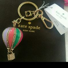 NWT Kate Spade Hot Air Balloon Key Ring Fob Charm NWT Kate Spade New York 3D Hot Air Balloon Enamel Keyfob Key Chain Charm Dust Cover WORU0062 Condition: Brand New with Tag Color: Multi with Rhinestone detail  Really cute Key chain by Kate Spade. Comes with dust bag.  2 MORE AVAILABLE BUT THIS LISTING IS JUST FOR ONE. PLEASE COMMENT IF YOU WANT TO PURCHASE.   Please ask all questions prior to purchase as all sales are final. Thank You! kate spade Accessories Key & Card Holders
