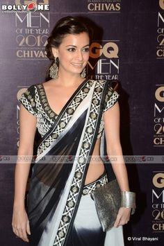 Dia in a black and white saree at a formal do.