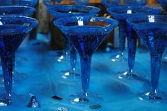 sprite, blue food coloring, and blue sugar crystals make a pretty drink at a boy baby shower