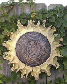 Ceramic sunflower will never fade. Handmade in Michigan by Black Cat Pottery.