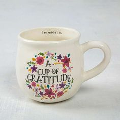 "Cup of Gratitude Happy Mug - With a handcrafted feel and generous 16-ounce size, this Happy Mug features an original floral design and ""Cup of Gratitude"" on the outside and ""I am grateful for..."" on inside rim. Perfect for reflecting during morning coffee!"