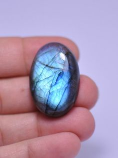 100 % natural Blue flash oval LABRADORITE cabochon. by MargoPhoto