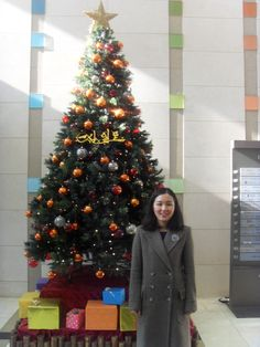 After the church service in front of a Christmas tree in the building. Have a good weekend and wish good effort for the final exam.