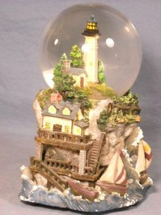LIGHTHOUSE SNOW GLOBE W/ COTTAGE & SAILBOATS, SEAGULL, SURF SOUND & LIGHTS