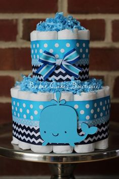 Mini 2 Tier Whale Diaper Cake, Boy Baby Shower, Blue Navy Whale Baby Shower Centerpiece, Under the Sea Baby Shower by BabeeCakesBoutique on Etsy https://www.etsy.com/listing/218493351/mini-2-tier-whale-diaper-cake-boy-baby