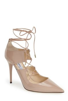 These patent nude lace-up Jimmy Choo pumps are going on the wish list.