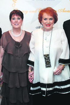 Maureen O'Hara, famous actress born in 1920 featured in many movies, often together with John Wayne (her PA Carolyn Murphy and Maureen hold hands at a function at the Eccles hotel in Glengariff, just two years ago [2012]).