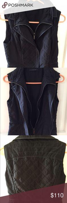 Elie Tahari double layer quilted vest Double layer quilted vest, inner layer zips, outer layer snaps. Adjustable drawstring mock-neck collar. So chic!! Elie Tahari Jackets & Coats Vests
