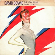 Sits like a man but he smiles like a reptile  she love him,  she love him but just for a short while , she'll scratch in the sand, won't let go his hand, he says he's a beautician and sells you nutrition, and keeps all your dead hair for making up underwear, Poor little Greenie..... The Jean Genie BECAUSE DAVID FUCKING BOWIE