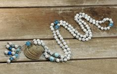 This mala necklace is crafted with 108 semi precious stones of mat howlite accented by sterling (925