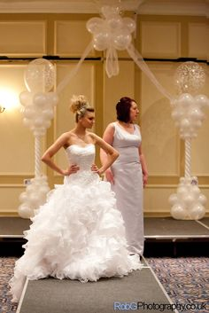 Wedding balloons. An all White Candy Cane Balloon Arch with cloud 9.