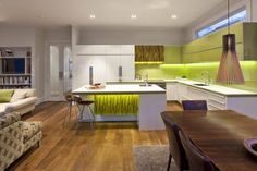 A bright green colour was selected for this kitchen. Set against the off-white cabinetry, the effect is fresh and clean.