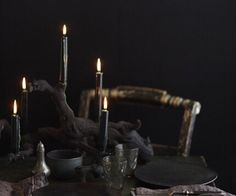 black halloween table setting dark dcor gnarly drift wood painted black bore holes for candle holders