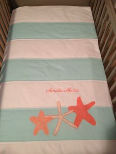 Striped Nursery Quilt in Aqua/White with Coral Starfish on Etsy, $120.00