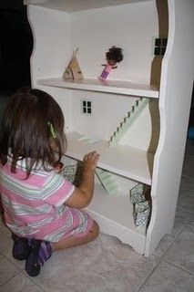 Old bookshelf --> new dollhouse.  could be super cute with lots of upgrades.  furniture from hobby lobby-