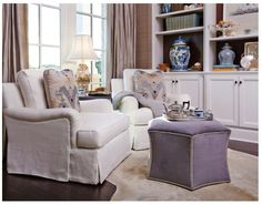 Love the neutral color scheme with touch of lavender.  Very warm room.
