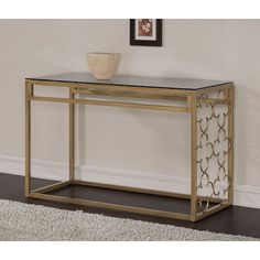 This stunning sofa table features a beautiful metal quatrefoil design with a clear glass top. The popular quatrefoil design is both scratch and mark-resistant, finished in a powder-finished goldtone color.