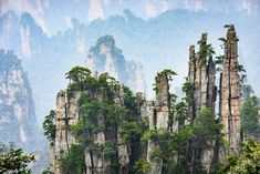 Zhangjiajie National Forest Park, China - This plush national forest is known for its unique geography and rock pillars that have formed as a result of physical erosion. Zhangjiajie, Beautiful Places In The World, Beautiful Places To Visit, Places To Travel, Places To See, Parque Natural, Iceland Waterfalls, Forest Park, Wild Forest