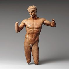 """Terracotta statuette of the Diadoumenos (youth tying a fillet around his head)"" (ca. 1st century BCE). Greece, Hellenistic period. Posted on metmuseum.org."