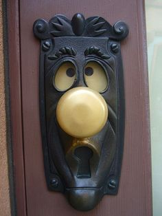 Doorknob. Turn the handle and the eyes change.
