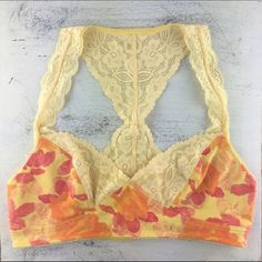 "[Free People] Galloon Lace Flora Bralette Yellow Gorgeous floral and lace Racerback style bralette. Pull on style. Lined. Perfect peeking out from under a tee or sweater.  Color: Sunshine Combo Fabric: 95% Cotton 5% Spandex Size: Medium Band Length: 13"" Condition: NWT!  No Trades! No PayPal! Free People Intimates & Sleepwear Bras"