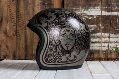 These are custom illustrated motorcycle helmets. The helmets are illustrated using a sharpie and sealed with an automotive clear coat. These helmets are DOT certified but should be considered art pieces. The artwork has not been tested to see how it would…