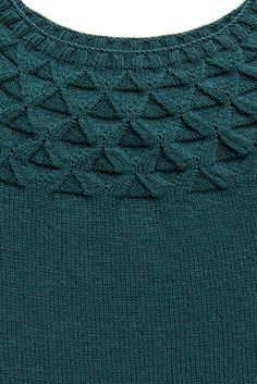 A beautiful geometric design graces the shoulders of this classic round yoke with sinuous lines and purled acorn caps at diminishing scale. Gentle waist shaping and carefully placed short rows ensure a comfortable fit, and a generous neckline adds to the comely, face-framing effect. This is a pullover to knit in your signature color, and Arbor's nuanced palette offers ample selection.