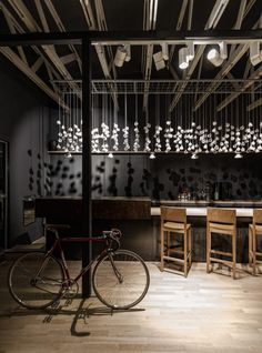 Origo, by Lama Architectura, is a coffee shop by day and a cocktail bar by night.The massiveness of the bar is contrasting with the 276 cups installation that Deco Restaurant, Restaurant Design, Modern Restaurant, Deco Design, Cafe Design, Design Weekend, Interior Desing, Showroom Design, Coffee Shop Design