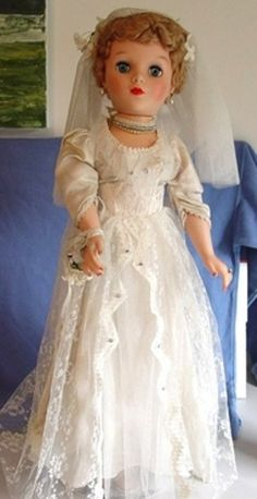 I got a bride doll like this for my fourth birthday, and kept her for many years!