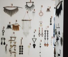 Levine's porcelain and stoneware mobiles, some looped on pieces of wood from her travels, covered at least six walls in a space facing Weyburn Ave.