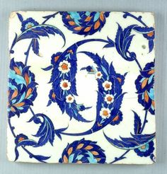 Tile with 'Saz' leaf spiral and lotus, c. 1520-1540  Architectural Element  Turkish  ,  16th century  Ottoman Empire, AH 680-1342 / AD 1281-1924  Creation Place: Iznik, Turkey  Underglaze polychrome painted fritware  30.7 x 30 x 2.5 cm (12 1/16 x 11 13/16 x 1 in.)
