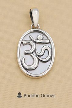 Ancient and curving Om symbol set against a shimmering Mother of Pearl inlay. Om Pendant, Pearl Pendant, Om Symbol, Spiritual Jewelry, Mother Pearl, Belly Button Rings, Im Not Perfect, Pendants, Spaces