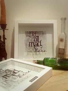 A classic Paper Panda piece and probably the most popular, this simple yet striking handcut typographical papercut says it all for any fan of Alice in Wonderland.The cut is suspended between two pieces of glass over the background casting awesome shadows. The background has been printed with the original Tenniel illustration of Alice and the Cheshire Cat with words from the original story.Framed in a handmade wood frame made especially for Paper Panda it is finished with the...