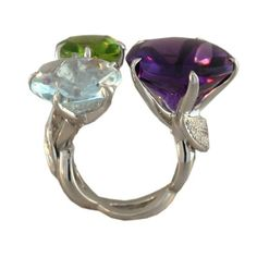 Striking oversize aquamarine, peridot and amethyst ring with pave diamond leaf side motifs by CHANEL Paris.Contemporary