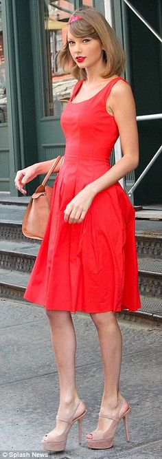 Walking advertisement: The 24-year-old was all decked out in Red, like the title of her most recent album