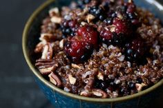 milk, quinoa, blackberries, cinnamon, pecans, dark honey. amazing stick-to-your-ribs breakfast.